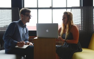 Male and female office workers in conversation