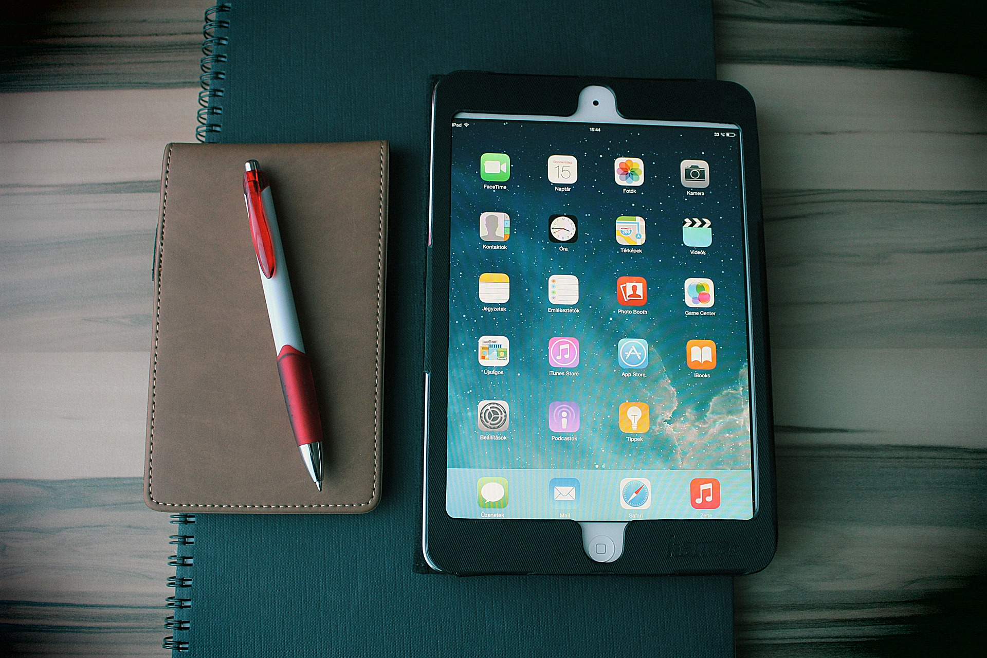 Image of iPad, notebooks and pen