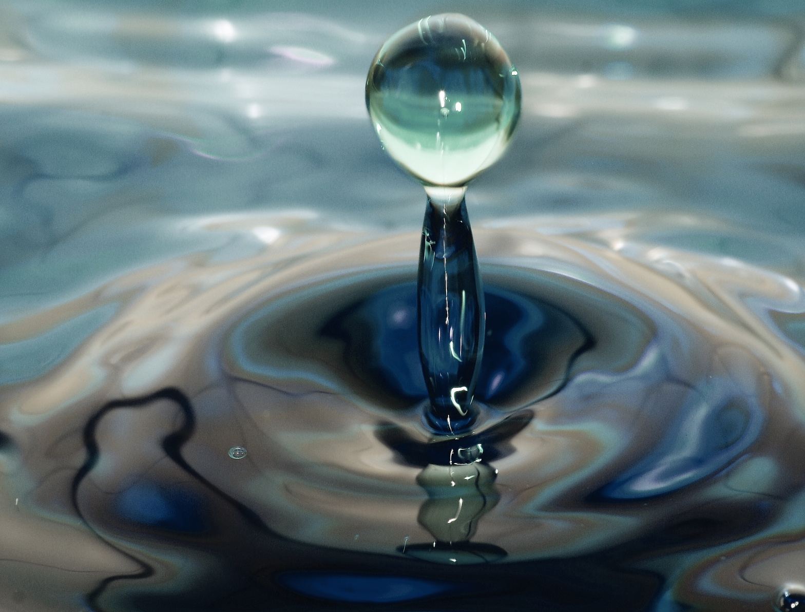 A stop motion image of water after something has been dropped on the surface.